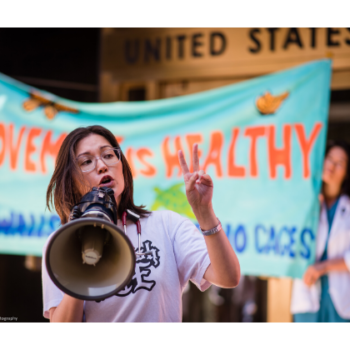 Action shot of Amber Akemi Piatt at a Close The Camps Rally in August 2019.