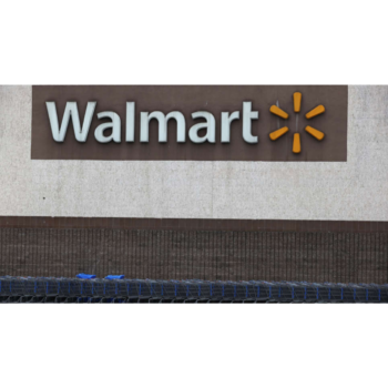 Photograph of the exterior of a Walmart store shows the store's sign